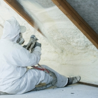 spray_foam_hose_spraying_in_attic
