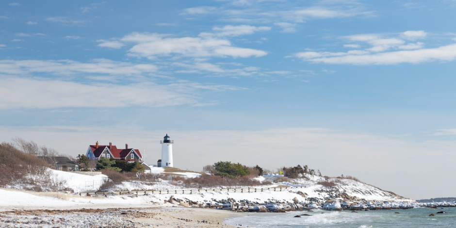 lighthouse_overlooking_cape_cod_beach